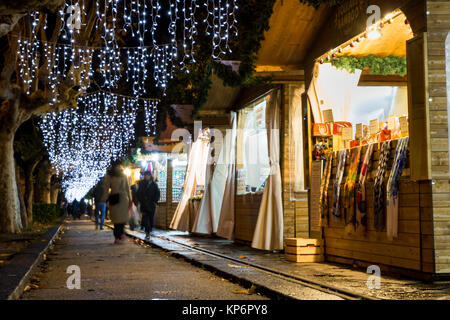 SALERNO - ITALY, December 13, 2017: people doing shopping in the Christmas market kiosks of city during the event - Stock Photo