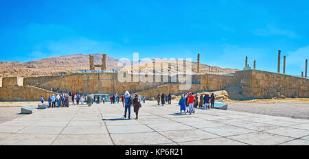 PERSEPOLIS, IRAN - OCTOBER 13, 2017: People visit world famous archaeological site, located on the plateau in Zagros - Stock Photo