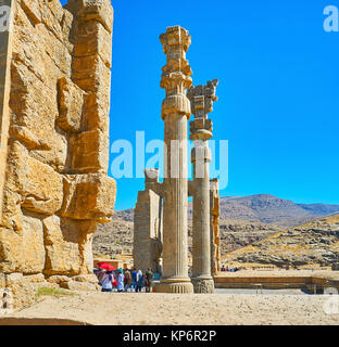 PERSEPOLIS, IRAN - OCTOBER 13, 2017: The ruins of All Nations Gate (Xerxes Gate) with preserved slender carved columns, - Stock Photo