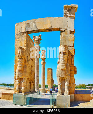 PERSEPOLIS, IRAN - OCTOBER 13, 2017: All Nations Gate (Xerxes Gate) with its preserved statues, decors and columns - Stock Photo