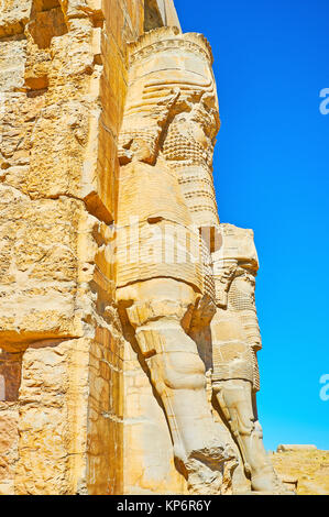 The side view of Lamassu (Assyrian deity) statues, decorating the All Nations Gate (Xerxes Gate) in Persepolis archaeological - Stock Photo