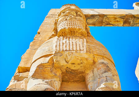 Passing by the giant statue of Lamassu - the ancient Assyrian protective deity, guarding th eastern entrance to - Stock Photo