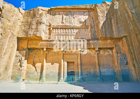 PERSEPOLIS, IRAN - OCTOBER 13, 2017: The facade of the ancient tomb of Artaxerxes III, located on the slope of Rahmet - Stock Photo