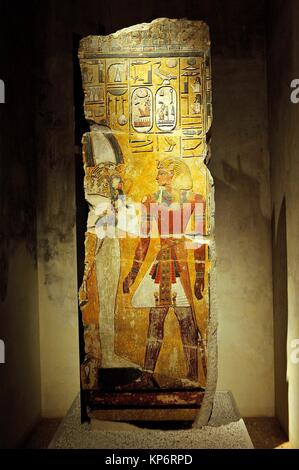 Fragment of a pillar depicting the King Seti I and the God Osiris. New Kingdom. Neues Museum. Berlin, Germany - Stock Photo