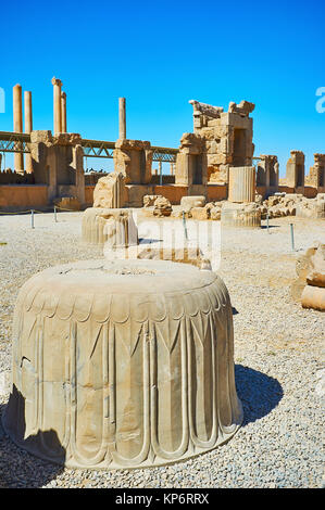 The ancient columns' capitals with preserved carved patterns in Persepolis archaeological site, Iran. - Stock Photo