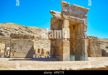The ancient gate, consisting of the giant boulders is one of preserved details of Hundred Columns Hall, Persepolis, - Stock Photo