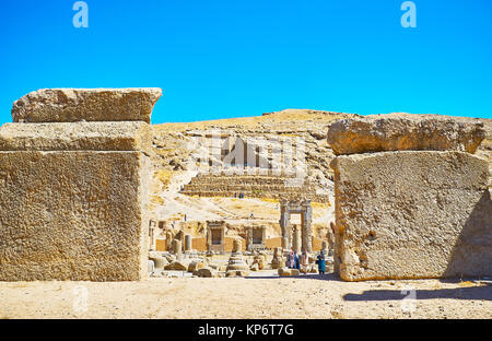PERSEPOLIS, IRAN - OCTOBER 13, 2017: The view on the Artaxerxes III Tomb, located on the mountain slope, through - Stock Photo