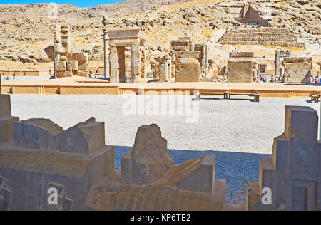 The view from Eastern Stairway of Apadana on the ruins of Hundred Columns Hall and Artaxerxes III Tomb on the background, - Stock Photo