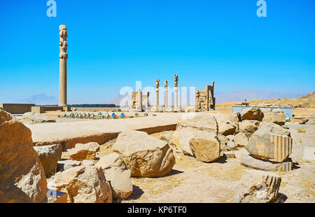 The site of ruined Apadana palace with a view on All Nations Gate on the background, Persepolis, Iran. - Stock Photo