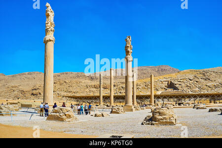PERSEPOLIS, IRAN - OCTOBER 13, 2017: The walk in archaeological site of Apadana palace with preserved slender columns, - Stock Photo