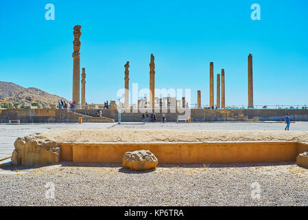 PERSEPOLIS, IRAN - OCTOBER 13, 2017: The tall slender columns of Apadana palace - Audience Hall of the ancient Persepolis, - Stock Photo