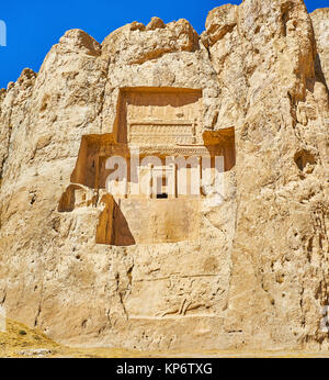 The carved in rock Mausoleum of Darius II in Naqsh-e Rustam Necropolis, from below can be seen preserved equestrian - Stock Photo