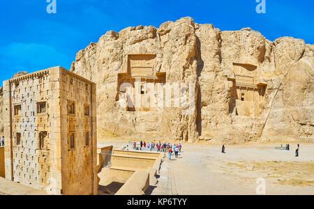 NAQSH-E RUSTAM, IRAN - OCTOBER 13, 2017: The mausoleums, cut in Hossein Mount and Ka'ba-ye Zartosht tower on the - Stock Photo