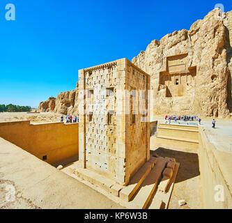 NAQSH-E RUSTAM, IRAN - OCTOBER 13, 2017: Discover Ka'ba-ye Zartosht tower and ancient mausoleums in rock in Naqsh - Stock Photo