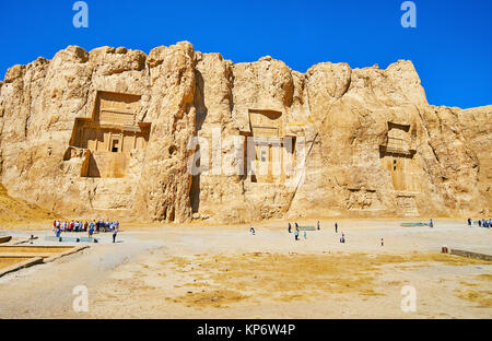 NAQSH-E RUSTAM, IRAN - OCTOBER 13, 2017: Panorama of the cliff with carved tombs of ancient Persian rulers, known - Stock Photo
