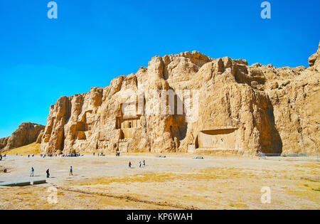 NAQSH-E RUSTAM, IRAN - OCTOBER 13, 2017: Panorama of Naqsh-e Rustam Necropolis - Hossein Mount with mausoleums on - Stock Photo