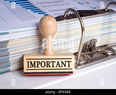 Important stamp with binder in the office - Stock Photo