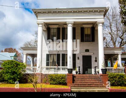 Old historical colonial house with huge three white columns that take place on the porch in the old town of New - Stock Photo