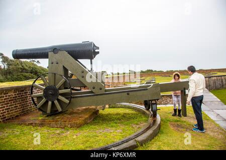 Handsome caucasian dark hair Father and preteen caucasian daughter taking a look at old canons in an old fort. Fort - Stock Photo