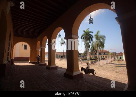 View from Casa de la Cultura to the Plaza Mayor-Main Square in the town center with a man on a donkey in the foreground, - Stock Photo
