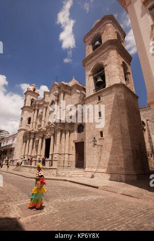 Woman with traditional costume in front of the Cathedral at Plaza De La Catedral-Cathedral Square, Havana Vieja, - Stock Photo