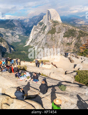 Half Dome Yosemite view from Glacier Point Overlook with people family taking pictures. Yosemite National Park California - Stock Photo