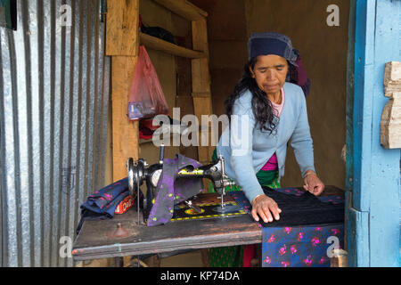 Nepalese seamstress at work in the village of Bahundanda, Lamjung district. - Stock Photo