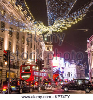 Christmas 'Angel' on Regent Street looking towards PIccadilly Circus, London. A taxi is waiting to cross the road - Stock Photo