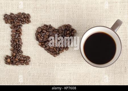 coffee beans and coffee cup forming i love you - Stock Photo