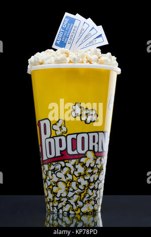 popcorn and tickets isolated on the dark background - Stock Photo