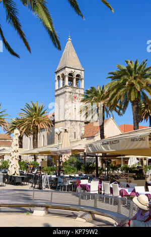 Seafront promanade looking towards Church of St Dominic, Trogir Old Town, Croatia - Stock Photo