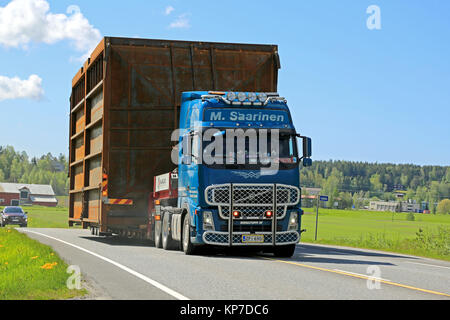 SALO, FINLAND - MAY 31, 2015: Volvo FH truck hauls a wide load along highway accompanied by escort cars. On Finnish - Stock Photo