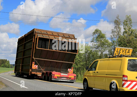 SALO, FINLAND - MAY 31, 2015: Escort cars accompany an exceptional load transport along highway. On Finnish roads - Stock Photo