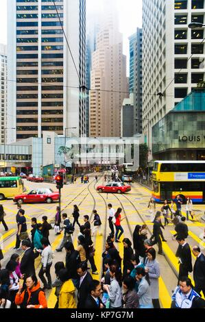 Rush hour at crossing of Pedder St. Chater Road and Des Voeux Road, Central, Hong Kong Island, Hong Kong, China, - Stock Photo