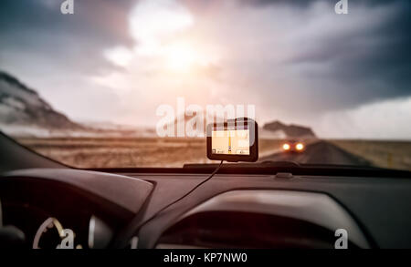 GPS navigator in the car, modern device to find right route, electronic maps all over the world, global positioning - Stock Photo