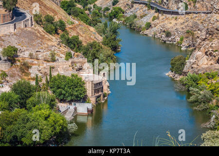 toledo,spain town skyline on the tagus river. - Stock Photo
