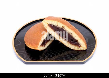 Dorayaki, Japanese confectionery on white background - Stock Photo