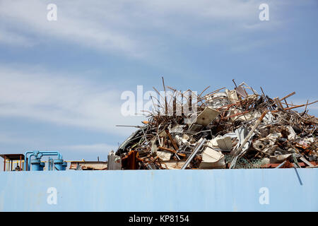 Pile of scrap metal at a recycling facility - Stock Photo