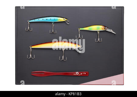 Plastic fishing lure on tray - Stock Photo
