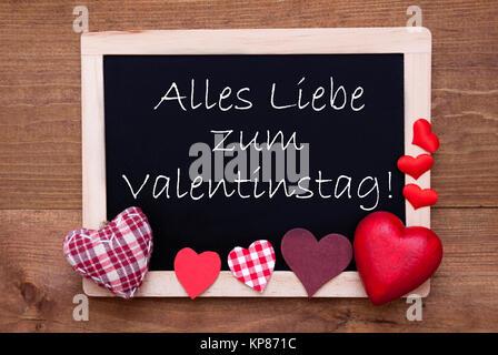 Blackboard With German Text Alles Liebe Zum Valentinstag Means Happy  Valentines Day. Red Textile Hearts