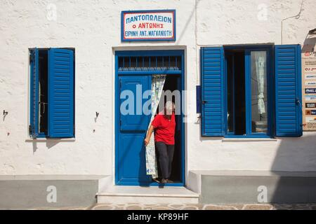 Local man in front of the market in the town center Chora or Chorio, Kimolos, Cyclades Islands, Greek Islands, Greece, - Stock Photo