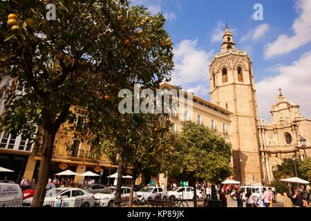 View to the'Miquelet' or 'Miguelete' tower (built in 14th century), Cathedral with orange trees in the foreground, - Stock Photo