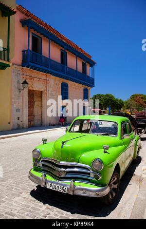 Old American car parked in front of the colonial building with balcony in Old Havana-Havana Vieja, La Habana, Cuba, - Stock Photo