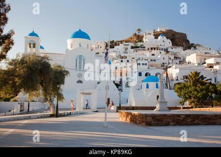Tourists taking photos in front of the blue domed churches in the old town Chora, Ios, Cyclades Islands, Greek Islands, - Stock Photo
