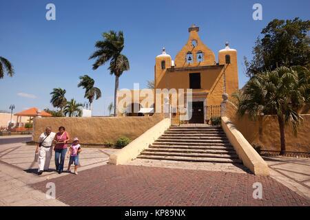 People in front of the Iglesia de La Ermita de Santa Isabel Church at the historic center, Merida, Yucatan State, - Stock Photo