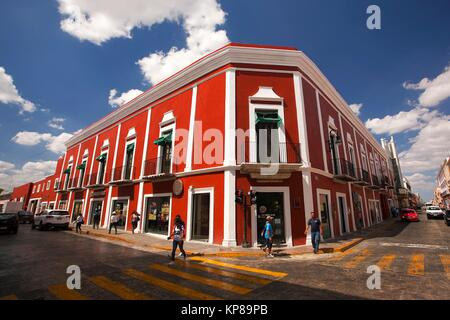 People crossing the pedestrian zone with the colonial buildings at the background in the city center, Merida, Yucatan - Stock Photo
