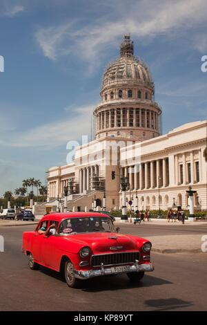 Old American car used as taxi in front of the Capitolio building in Central Havana, Cuba, West Indies, Central America - Stock Photo