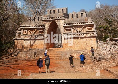 Tourists in front of the Labna Arch in the Labna Archaeological site, Puuc Route, Merida, Yucatan State, Mexico, - Stock Photo