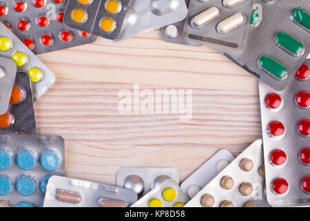 Pills and capsules in aluminum container - Stock Photo