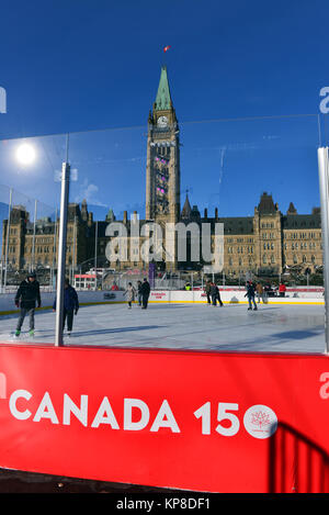 Ottawa, Canada - December 11, 2017:  The temporary skating rink erected on Parliament Hill as part of the Canadian - Stock Photo